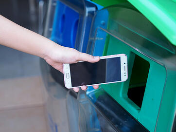 female-hands-are-dropping-old-cell-phone-into-trash_89729-377